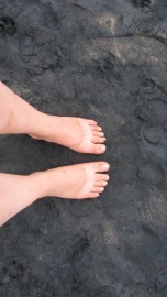 Black sand and a Birkenstock tan-line.